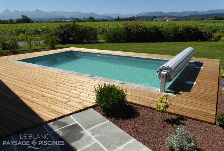 Piscine traditionnelle - dallage - aménagements paysagers - OSSUN 65 -